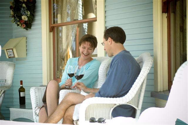 Guests enjoying wine on porch at haydon street inn