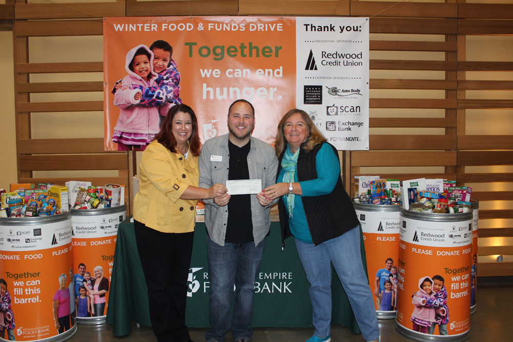 Beth Costa and Robin Caulkins giving the Wine Road donation check to the Redwood Empire Food Bank