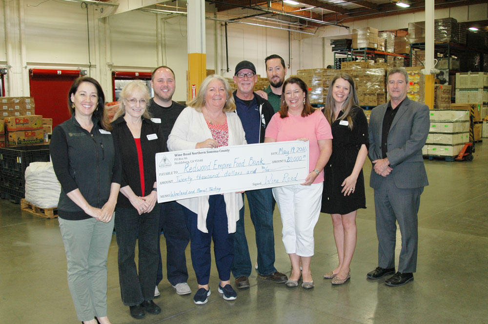 Wine Road Board Members and Executive Director Beth Costa present a $20,000 check to the staff at the Redwood Empire Food Bank