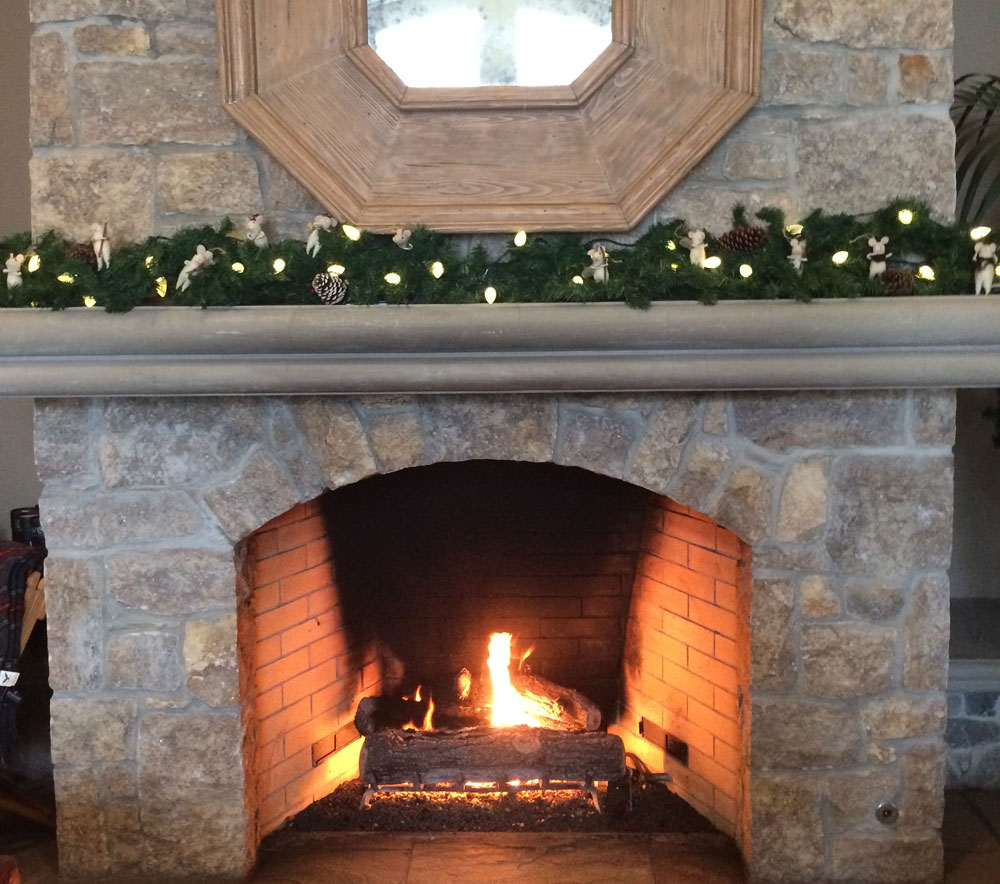 Holiday decorated stone fireplace