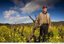 Fred Peterson standing in a vineyard in early spring.