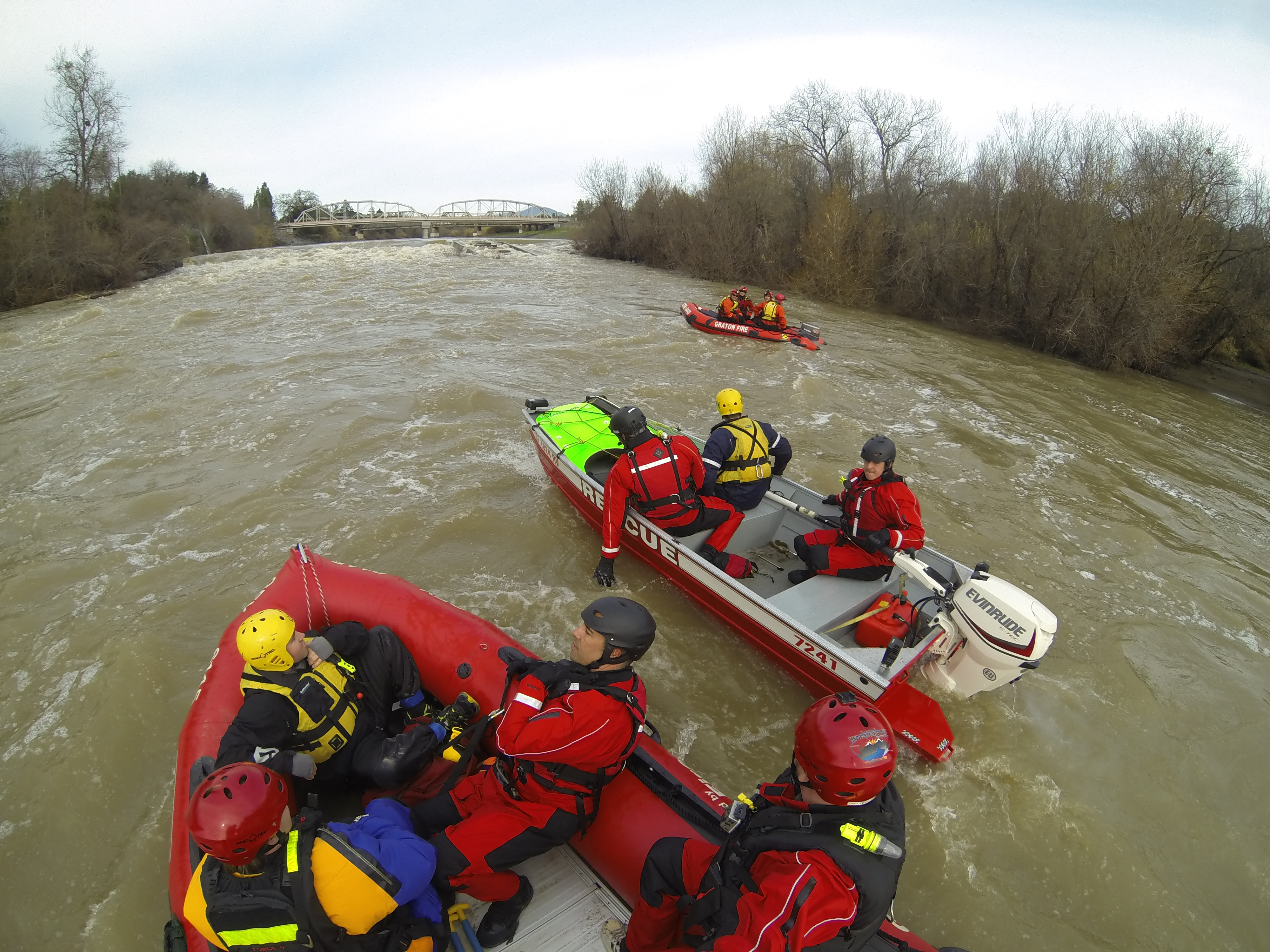 Firefighters doing a rescue in boats on the flooded Russian River.