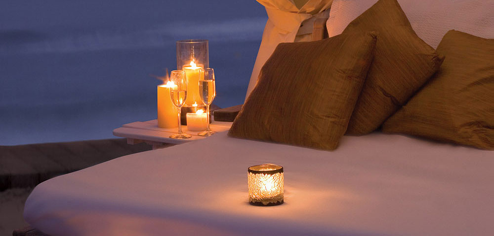 Romantic setting with a bed and candles.