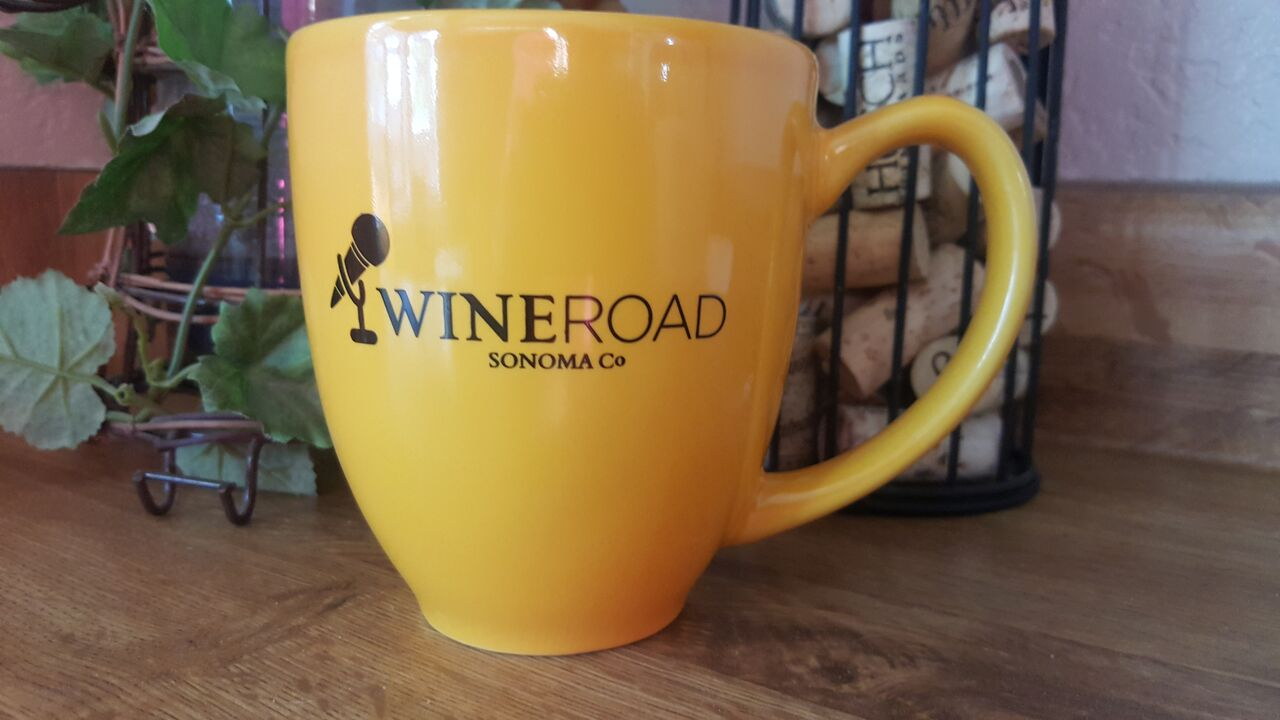 mug that has a microphone and the Wine Road logo