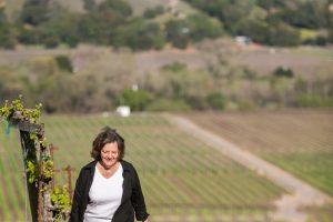 Phyllis Zouzounis walking in a vineyard
