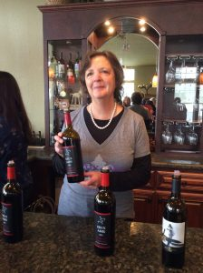Phyllis Zouzounis pouring her wines at the tasting bar