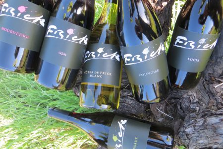 Six bottles of Frick wine with a mossy and rock background