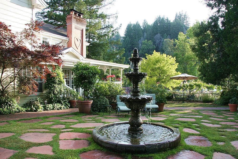The Inn at Occidental courtyard beckons you to sit and stay awhile.