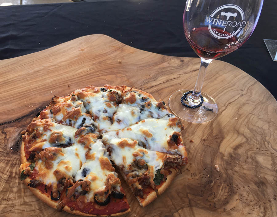 Pizza with a Wine Road wine glass from 2018 Wine & Food Affair