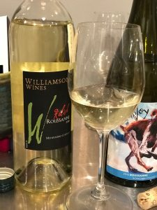 bottle of Williamson 2018 Roussane with wine in glasses