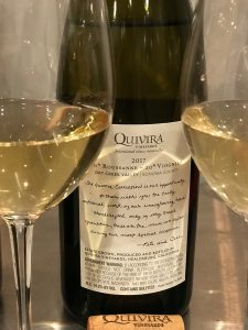 Bottle of Quivira blend of Roussanne Viognier between two glasses of wine