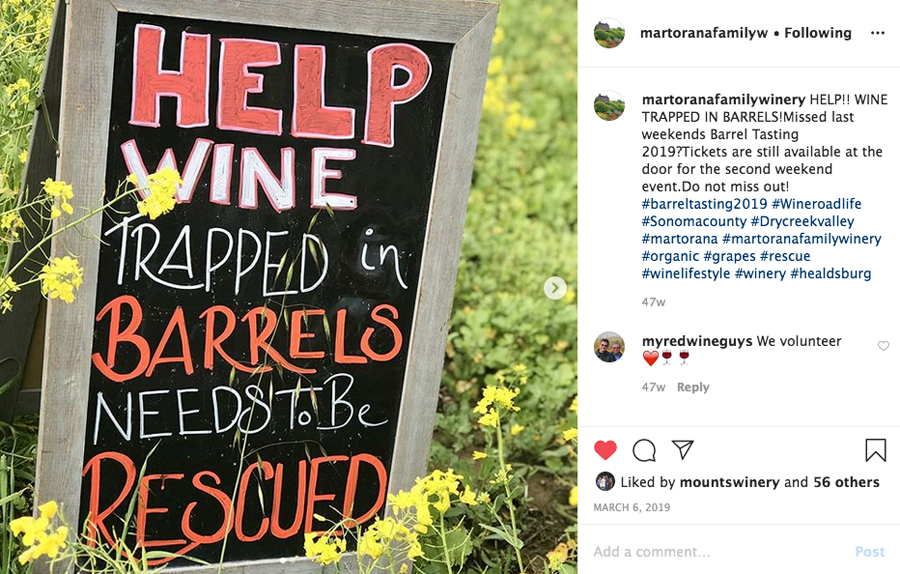 "Instagram post of a Sign that reads ""Help Wine Trapped in Barrels Needs to be Rescued"""