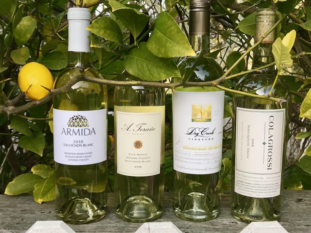 Bottles of Sauvignon Blancwith lemon tree in background