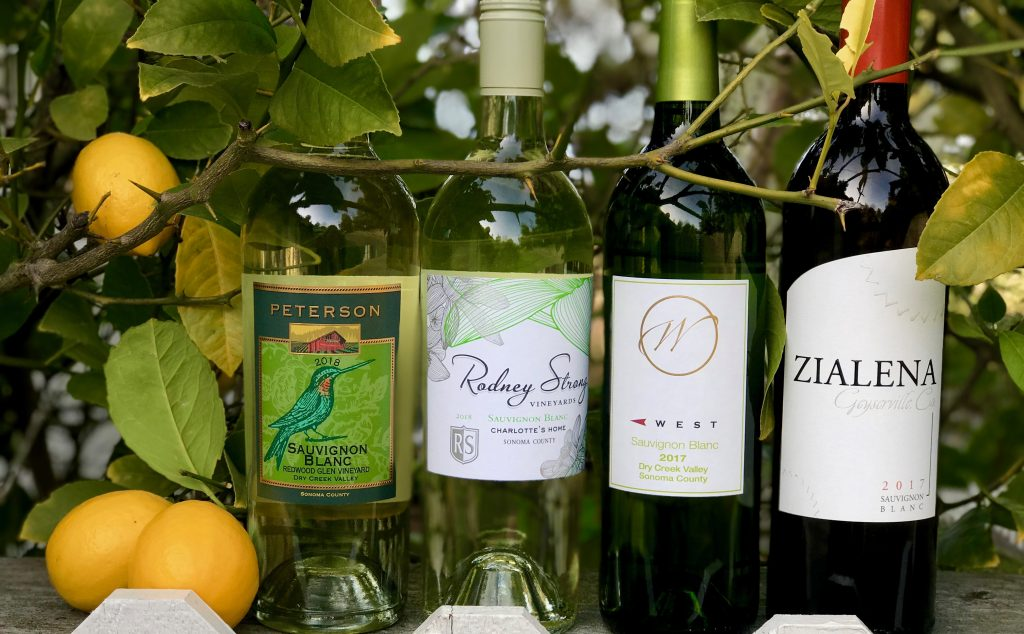 sauvignon Blanc bottles with lemon tree in background