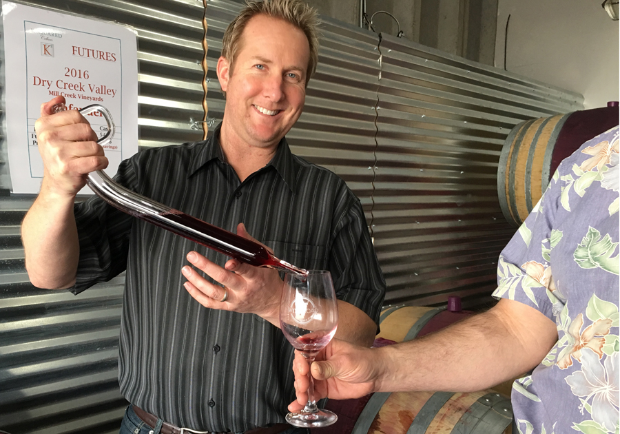 K Squared Cellars Winemaker and Owner Andrew Moore shares a barrel sample