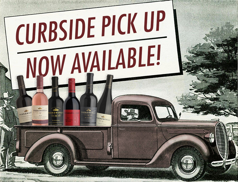 Vintage pickup filled with oversized bottles of Pedroncelli Winery wines with a sign above stating Curbside Pick Up Now Available.