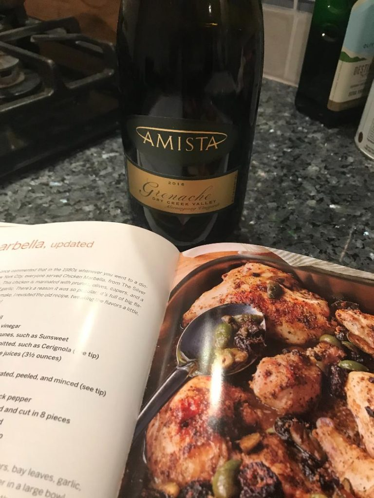 Recipe book with chicken marabella sn bottle of Amista Grenache