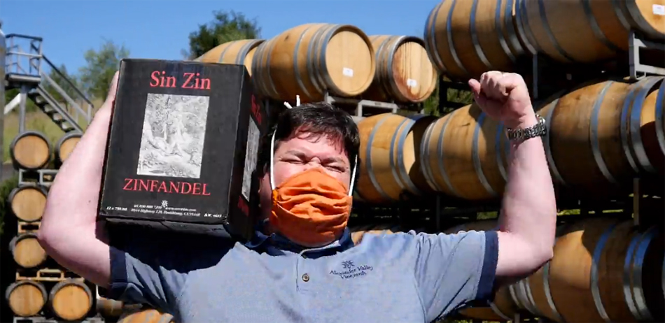 Harry Wetzel of Alexander Valley Vineyards carrying a case of Sin Zin with great enthusiasm