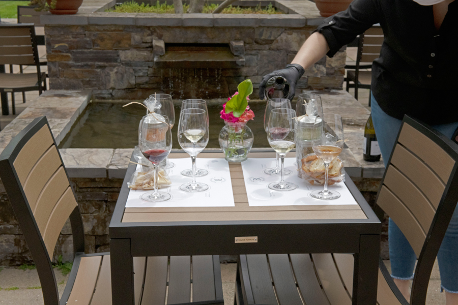 Table at Balletto Vineyards set up for wine and food experience.