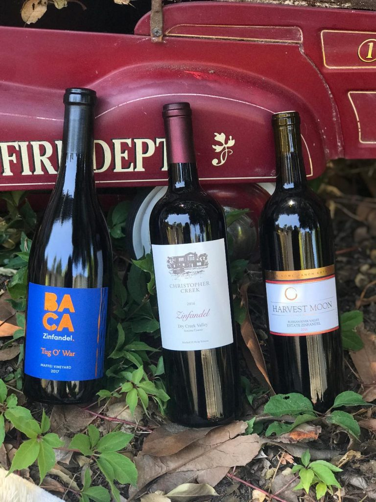 Zinfandel bottles leaning against a toy fire truck