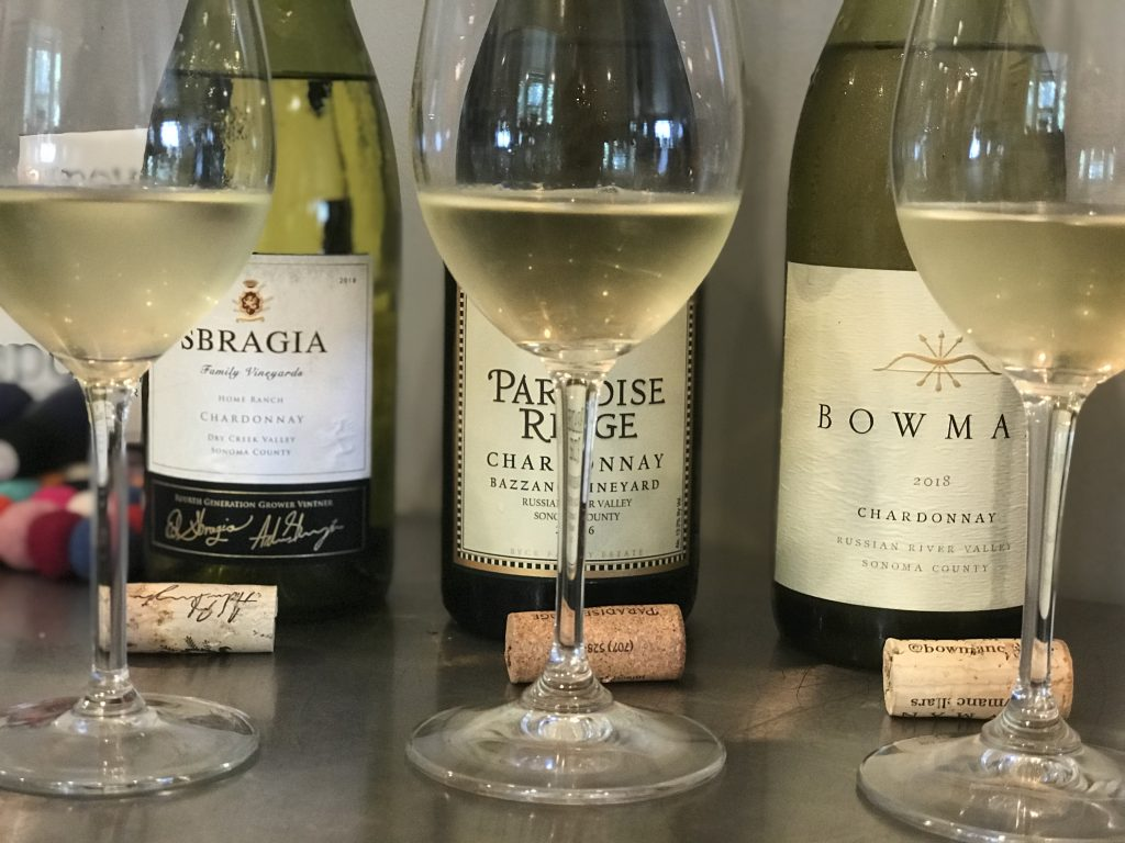 Chardonnay-in-glasses-with-bottles-of-Sbragia_ParadiseRidge_Bowman-in-the-background